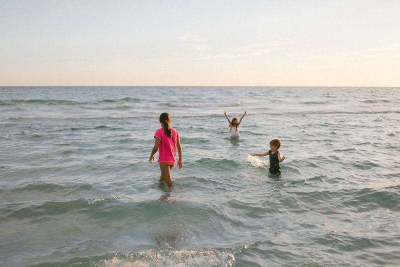Laurie Baker captures her children playing in the water during vacation