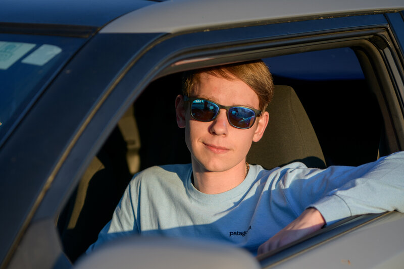 Rye Beach high school senior in car for photography session