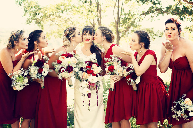 bridesmaids in red
