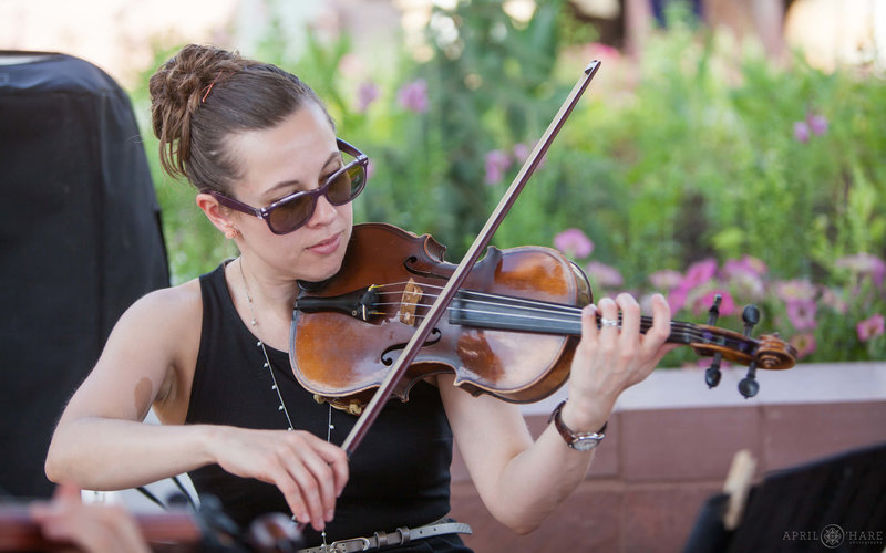 Violinist from Nexus Strings performs at an outdoor wedding at a summer wedding at Denver Botanic Gardens