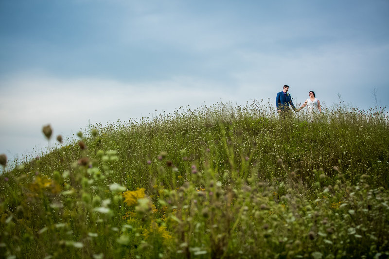 Couple on top of a hill Minneapolis wedding photographer