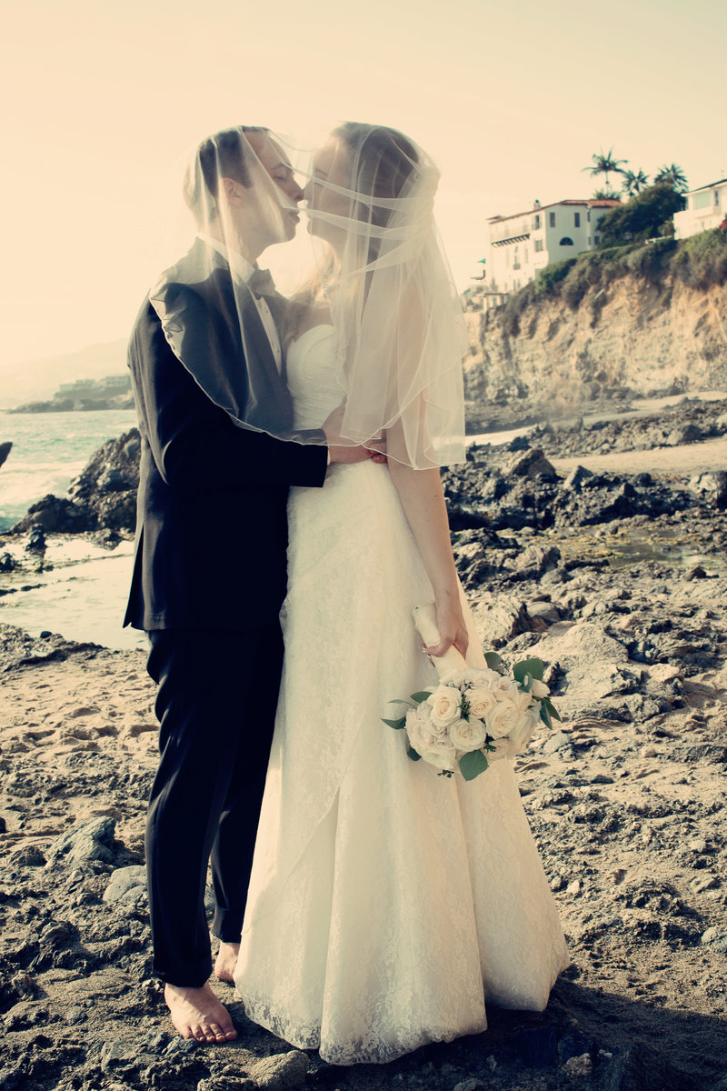 bride and groom at beach