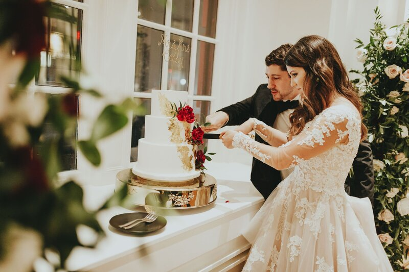 Newlyweds cutting their wedding cake