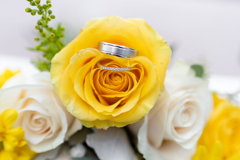wedding rings in yellow roses