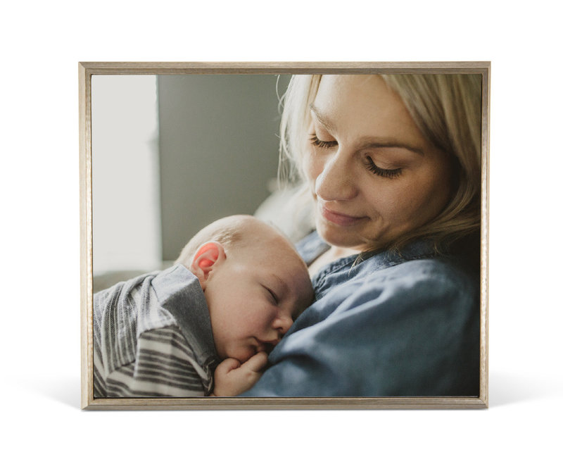 A wall portrait of a mother and her newborn by Darcy Ferris Photo.