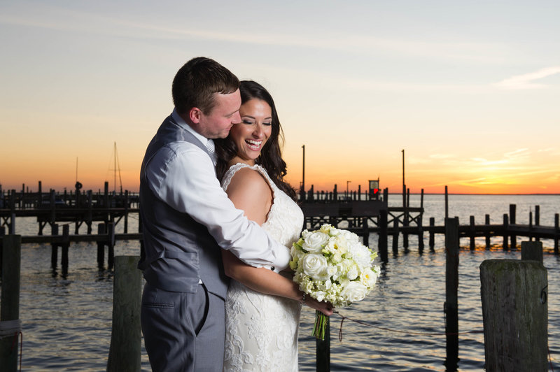bride and groom laugh at sunset at parkers garage