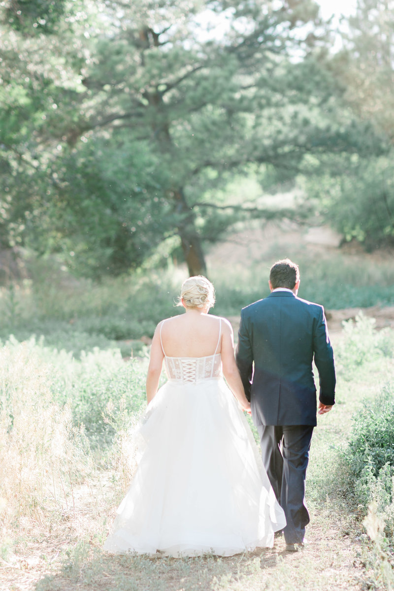 colorado bride and groom holding hands