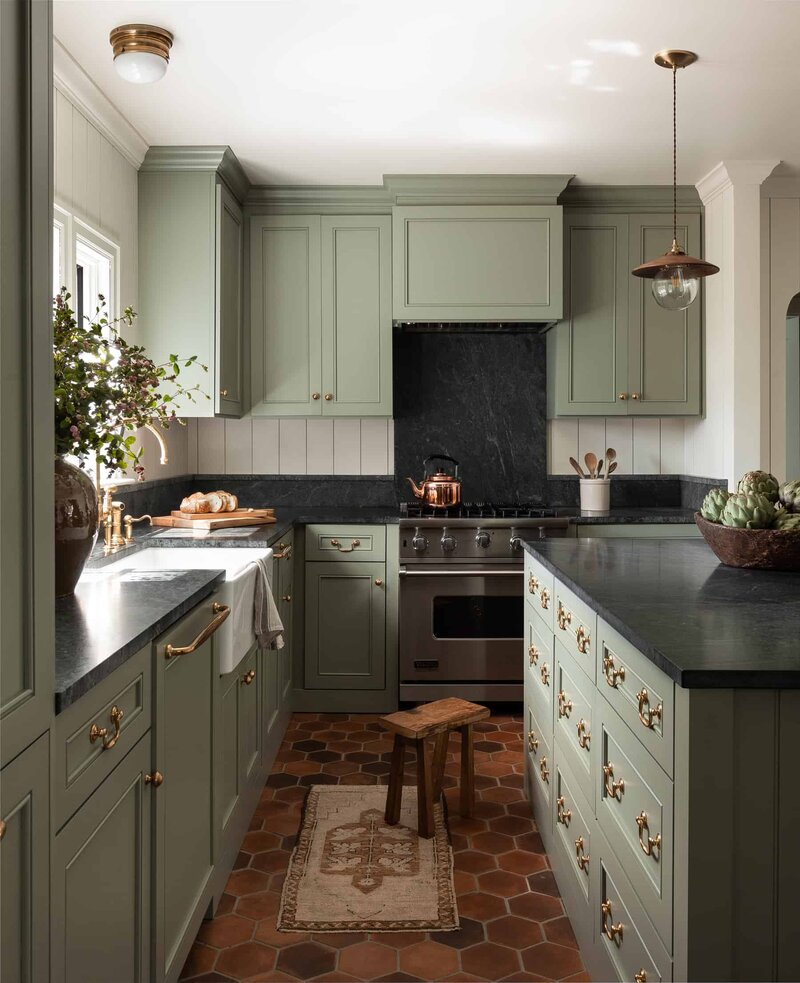 Heidi-Caillier-Design-Seattle-interior-designer-kitchen-green-cabinets-terracotta-floors-lantern-brass-cabinet-hardware-soapstone-countertops-shaker-cabinets-backsplash-farm-sink-1