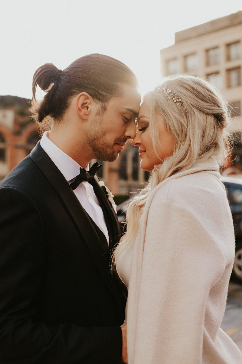 Couple at sunset in downtown Seattle by Seattle wedding photographer sarah anne photo