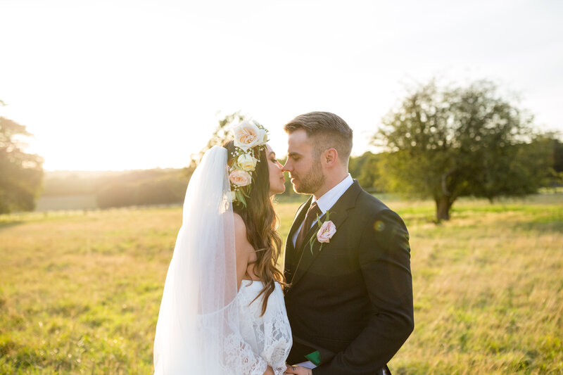 Bride and Groom kissing in golden hour in Essex wedding