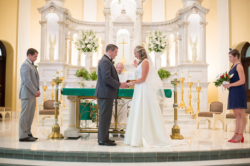 Bride and groom stand at the altar during St. Patrick's Church wedding