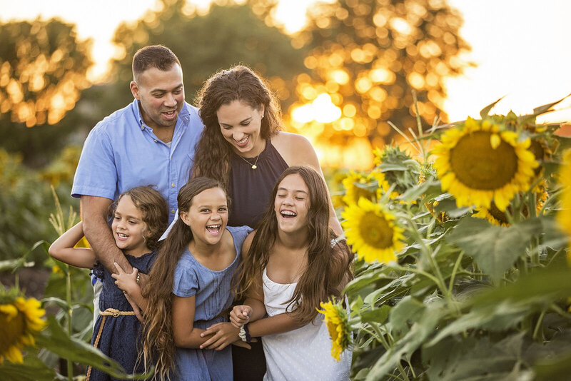 Family pictures at Britts Farm sunflower fields.