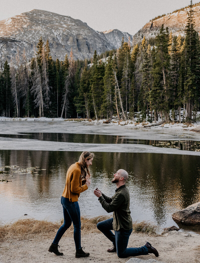 Surprise proposal in Rocky Mountain National Park, taken by Asheville wedding photographers.