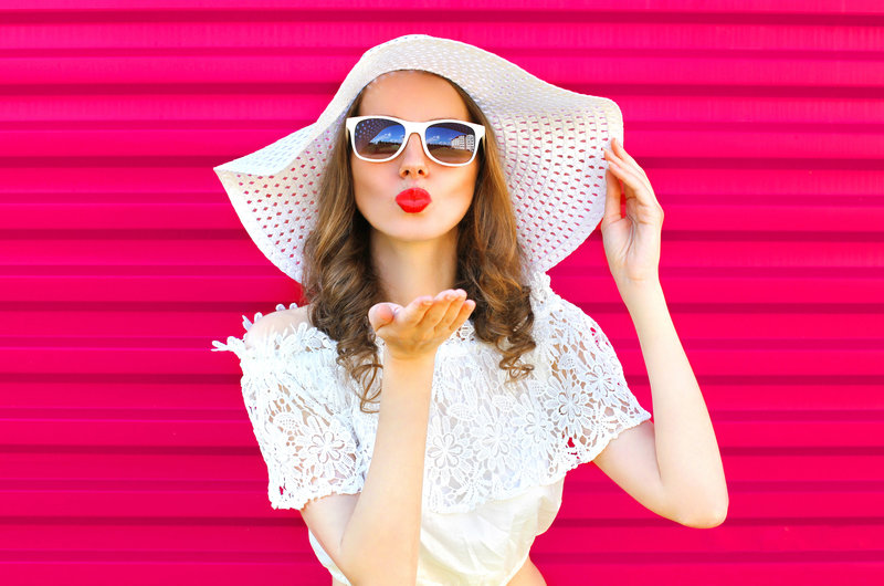 stock photo - woman white hat white dress bright pink background