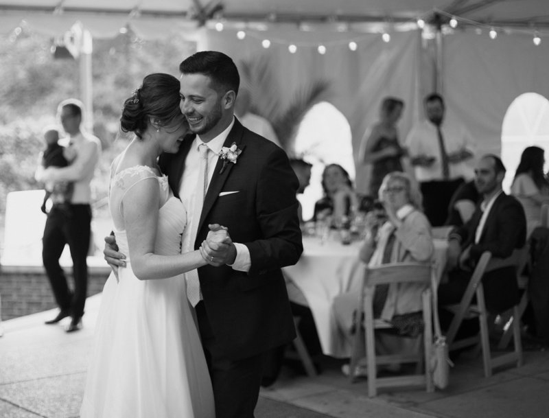 Bride and groom share first dance at their National Aviary  wedding reception in Pittsburgh, PA