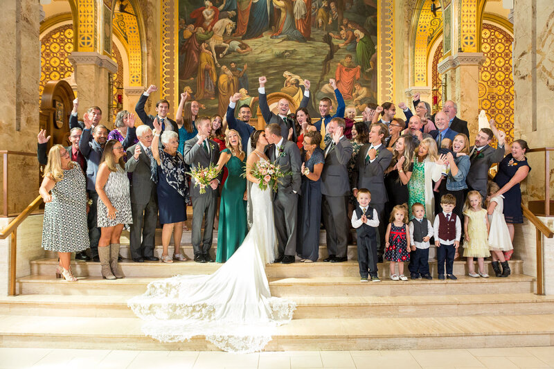 families celebrate on altar at downtown detroit catholic wedding