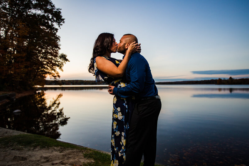 Engaged couple kissing on the shores of Edinboro Lake