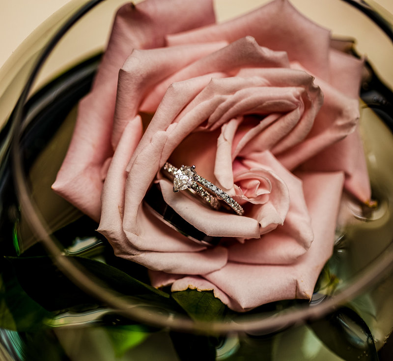 Wedding rings tucked inside the flower of a centerpiece at a Sheraton Erie Bayfront Hotel wedding