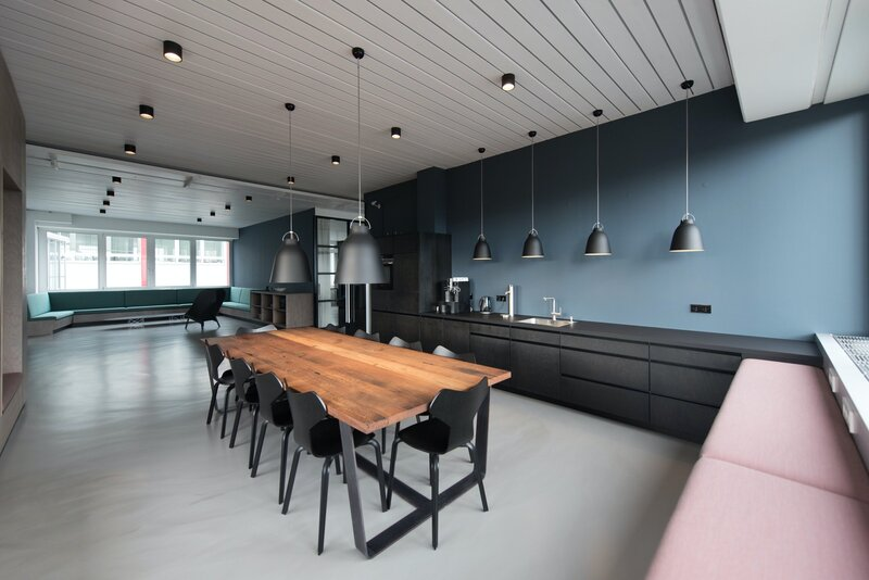 Dark blue walls in modern kitchen in Manhattan, KS