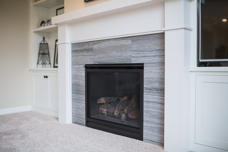 white fireplace with tile surround