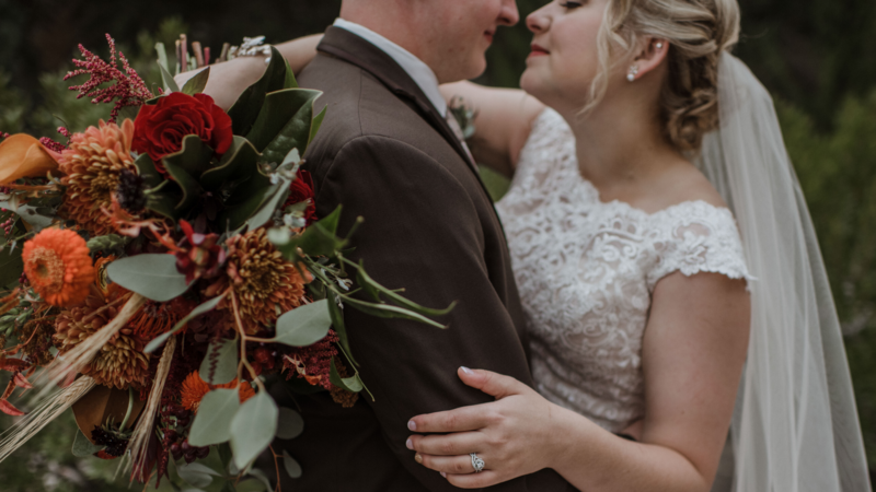 Wedding photo with fall colored flowers