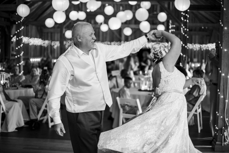 Bride dances with father at her Betsy's Barn wedding
