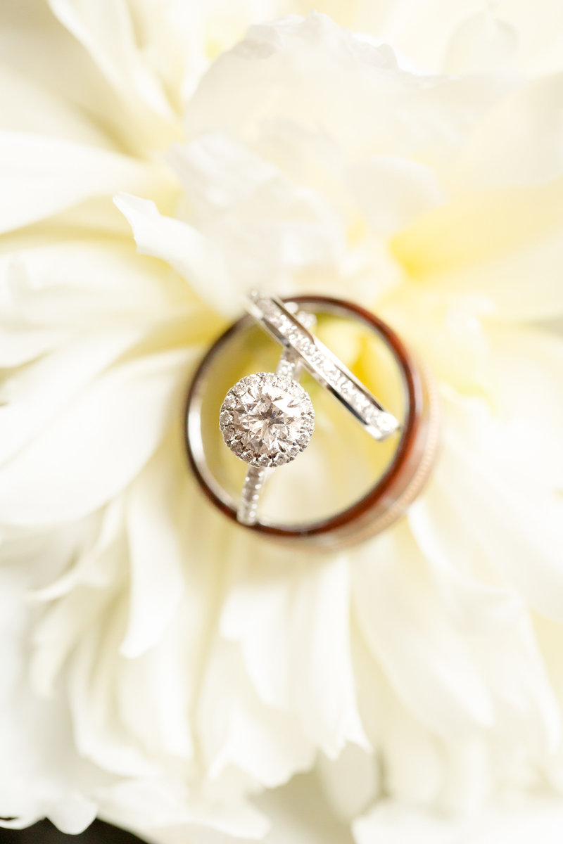 Wedding rings on white flower