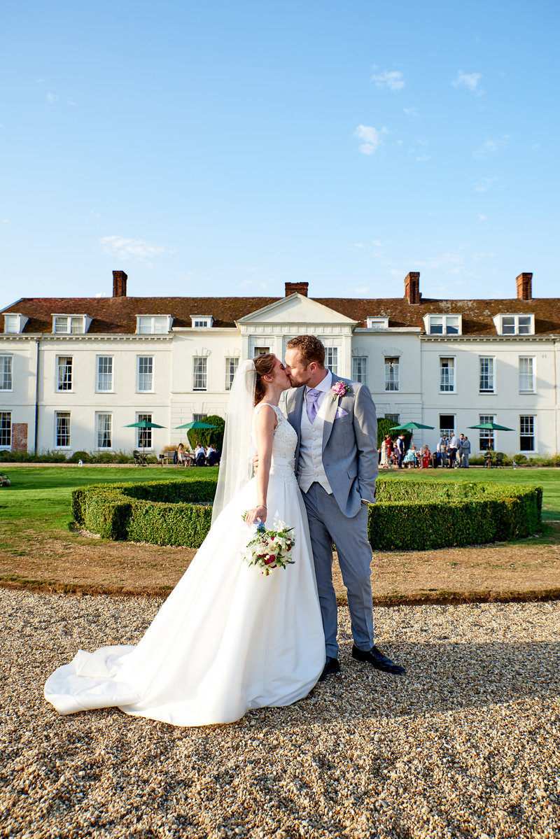 Essex wedding photographer  image of bride and groom at gosfield hall wedding venue in essex