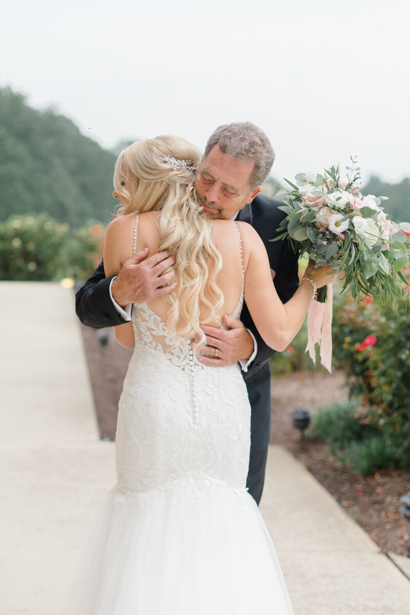 bride hugging father at Running Hare Vineyard Wedding photographer costola photography