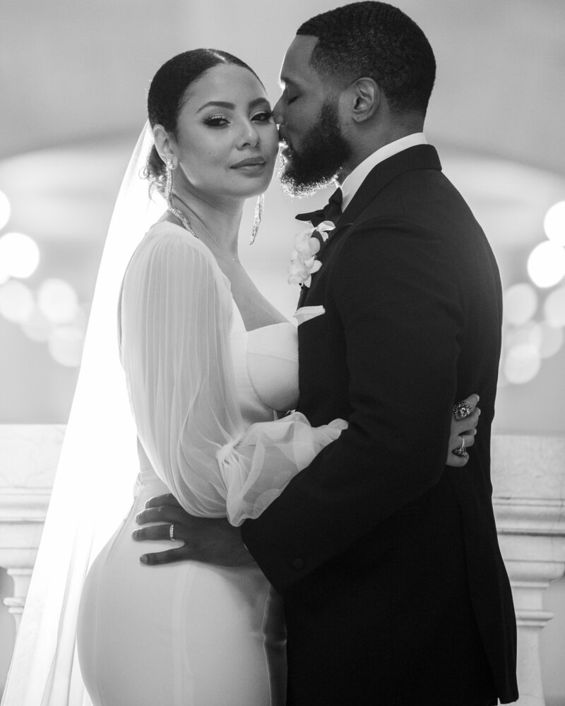 a bride and groom embracing in black and white