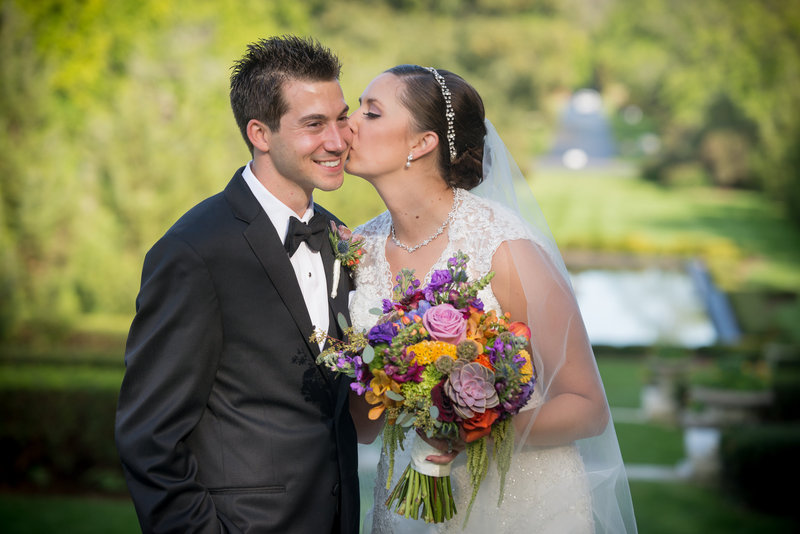 Cantigny-Bride-Kissing-Groom-Cheek