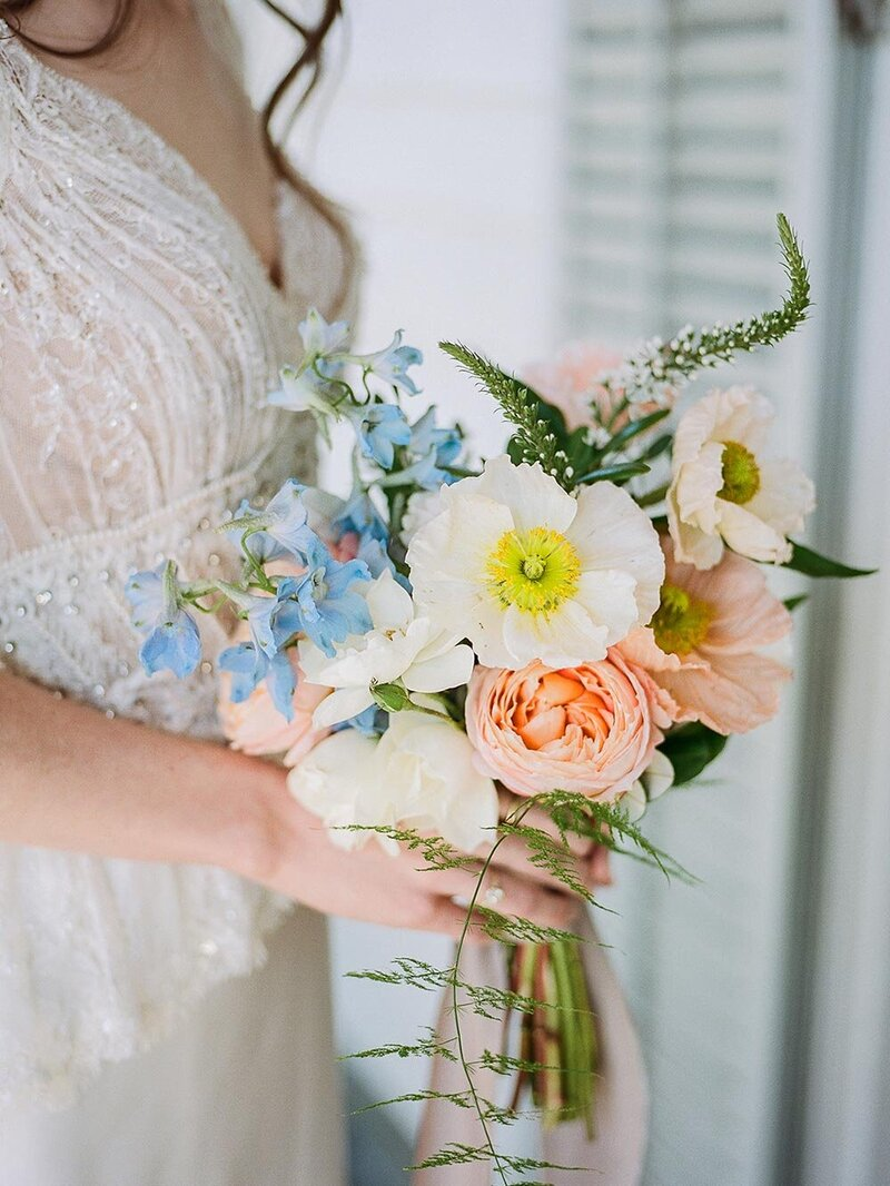 Close up of a bride holding a beautiful bouquet