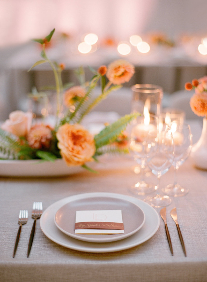 Orange tablescape. Welcome dinner party by Jenny Schneider Events at the San Francisco Ferry Building.