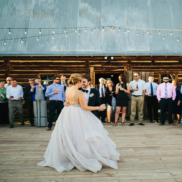 Strawberry-Berry-Creek-Dance-Floor-with-Market-Lights-for-Wedding-Reception-Bride-and-Groom-First-Dance-Kelsey-Stephen