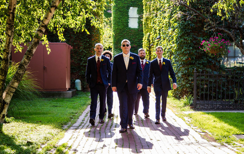 Groom and his groomsmen wearing sunglasses in Modern Tool Square