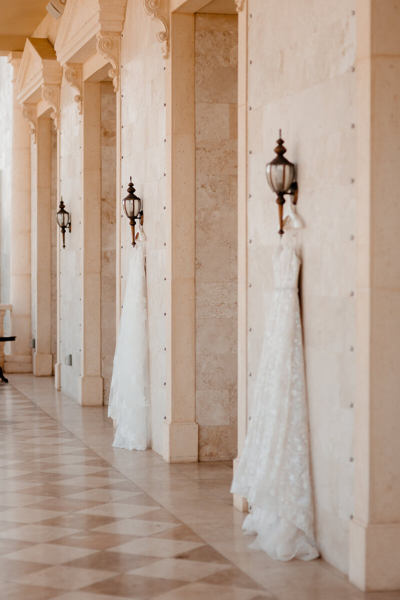 "alt=""two wedding dresses hanging at the regent weddeing"""
