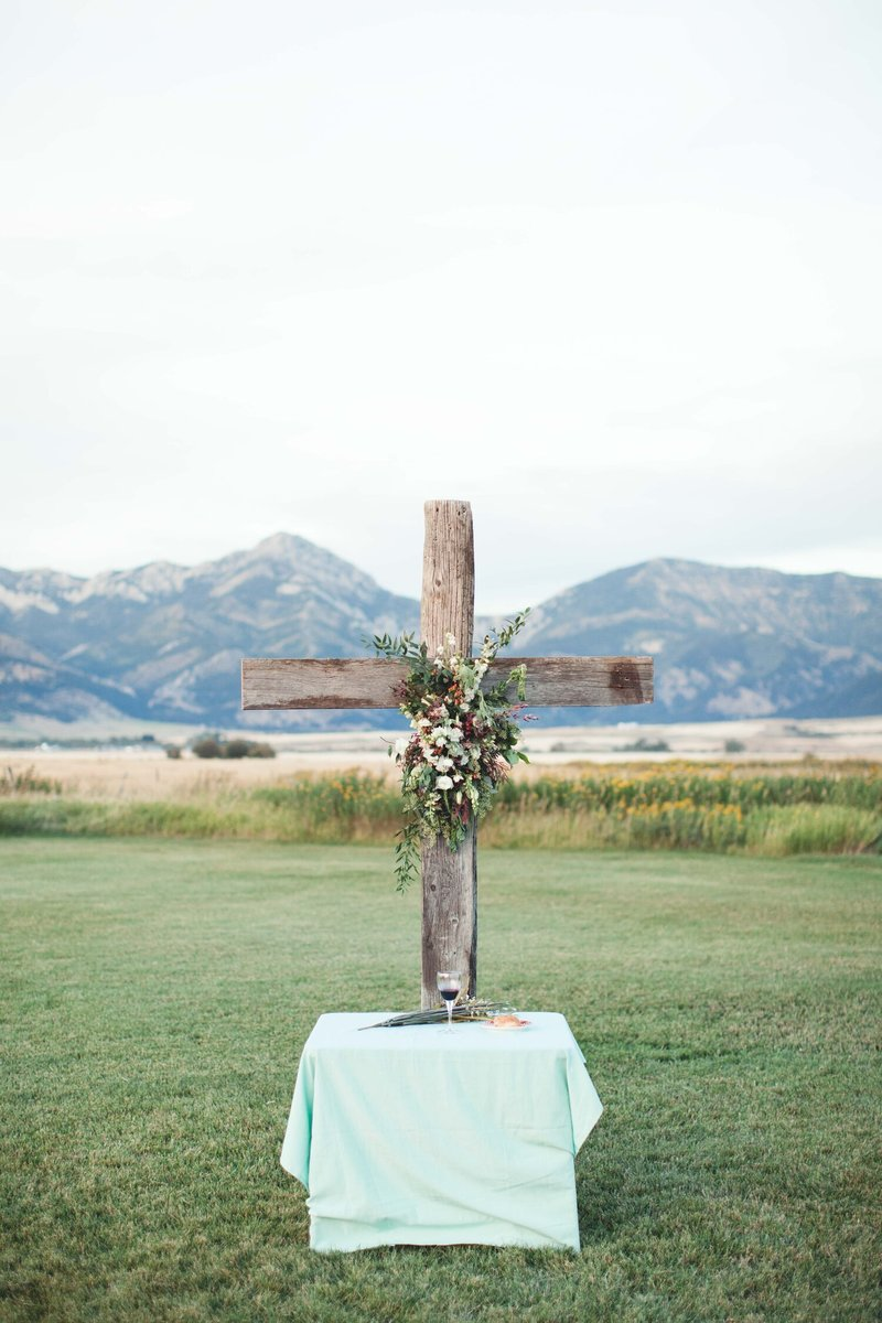 ceremony cross with flowers