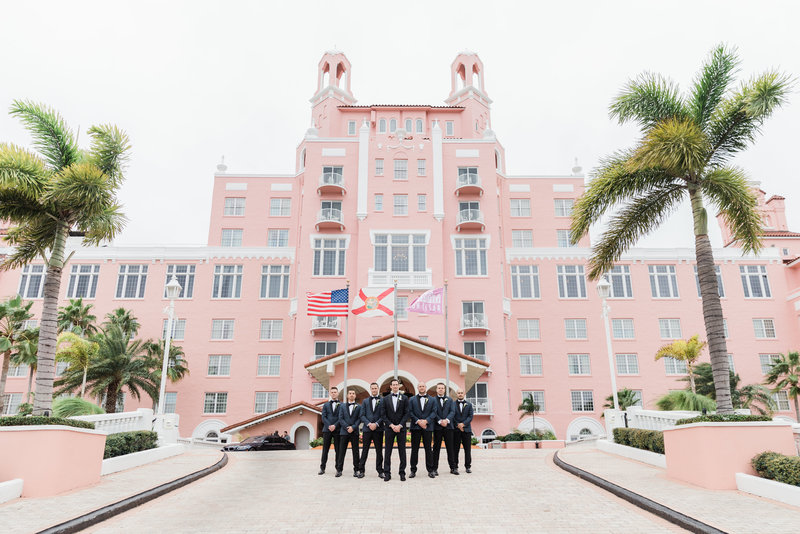 groomsmen standing in front of hotel at Don Cesar Wedding Photographer in St. Petersburgh Florida by Costola Photography