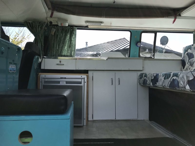 Inside  view of kitchen of Rhonda, teal retro kombi van from NZ Kombi Hire