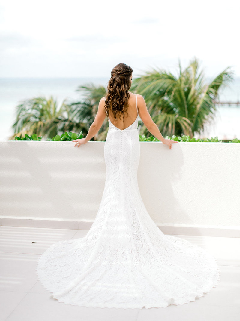 White strapless wedding dress  at the beach