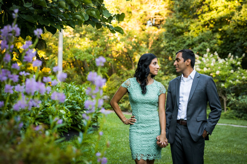 Couple holding hands during engagement photo session at sayen gardens hamilton nj