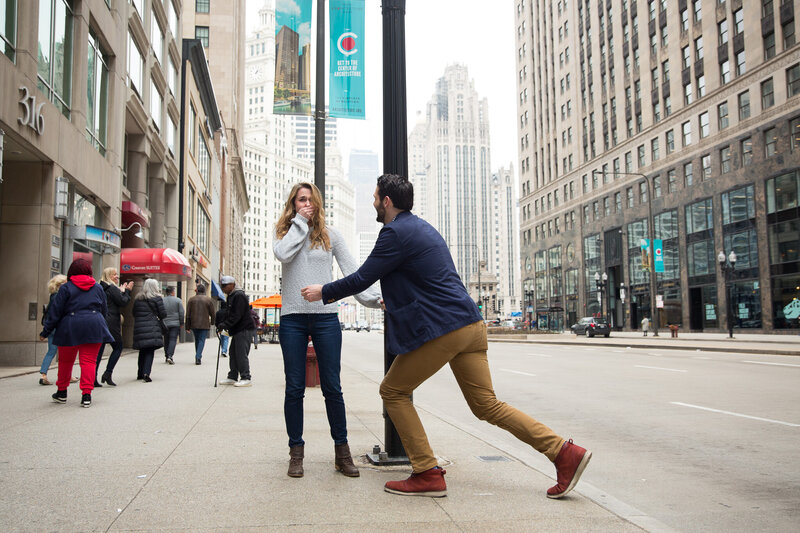 woman gasping woman gasping from surprise engagement downtown chicago mag mile