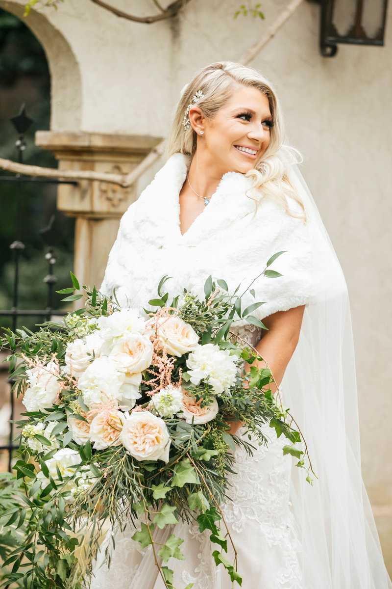 Bride with floral bouquet in St Louis