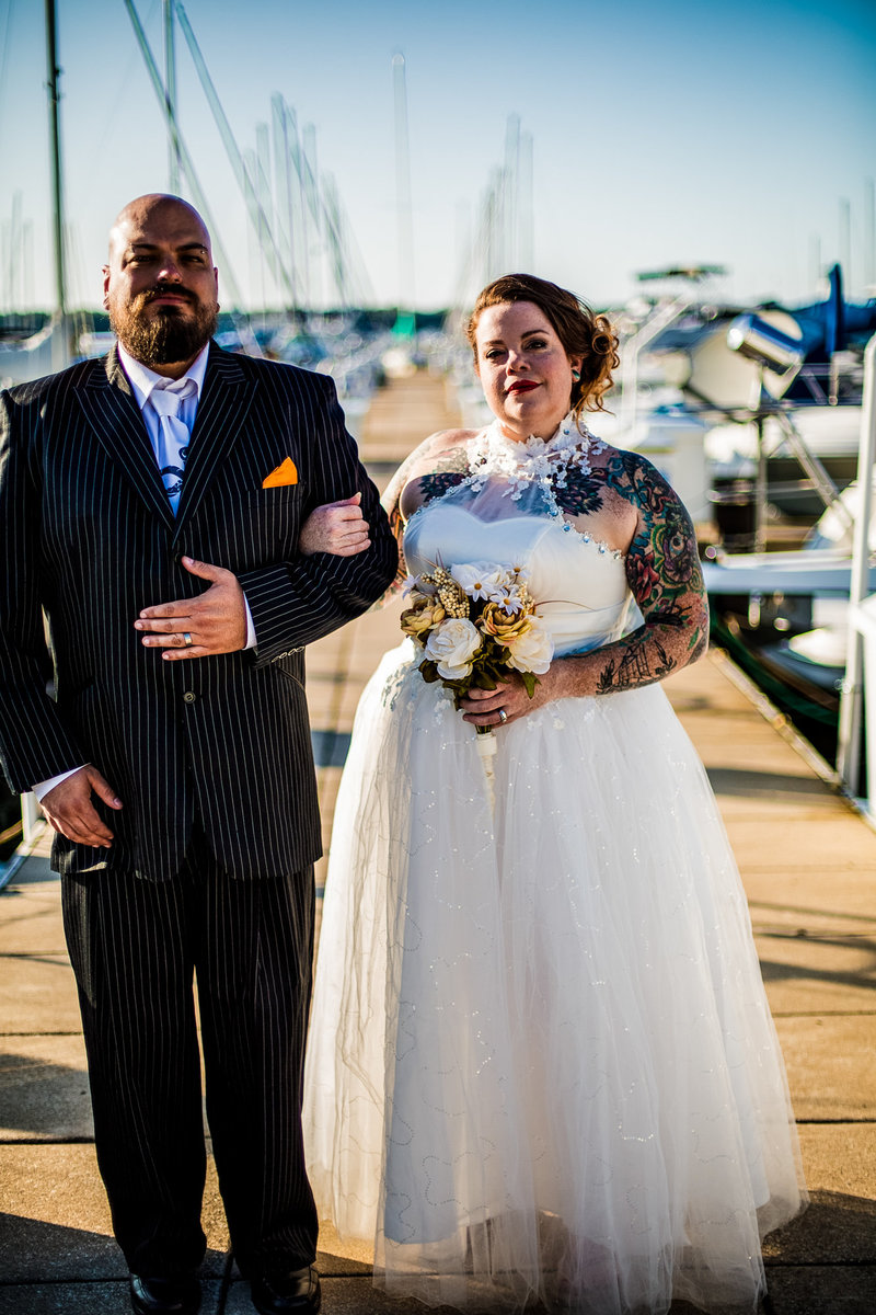 Bride and groom standing on the transient dock at the Erie Yacht Club