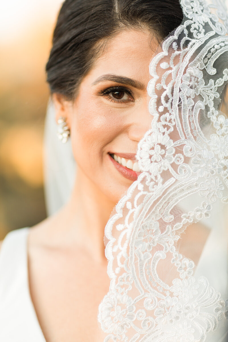 Photo of a bride with lace veil by Tina Pure In Art Photographer