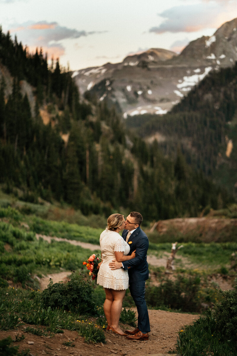 couple eloping on top of mountain at sunset in colorado