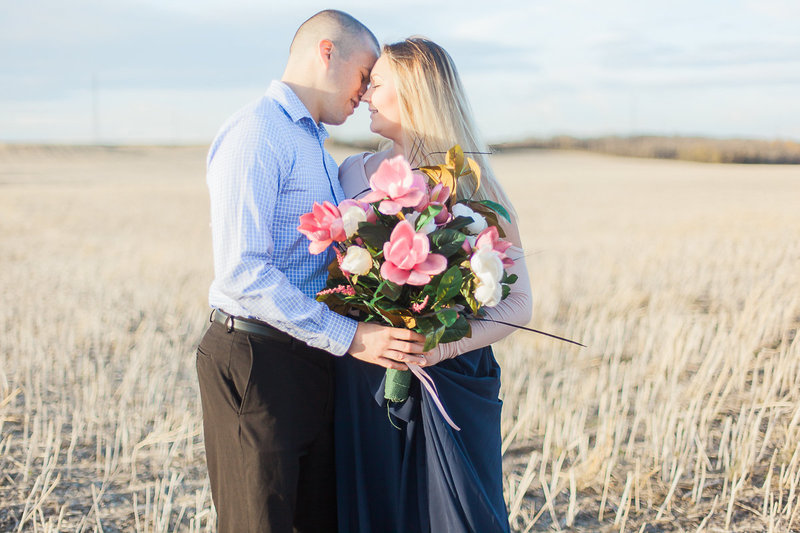 couple-embracing-wedding-day-just-married-sunset-session-sunflare-black-and-white-golden-hour-leduc-alberta-wedding-photographer-outstanding-in-a-field