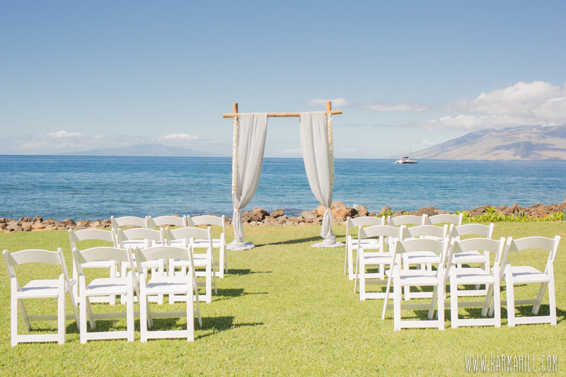 ocean front wedding set up with chairs