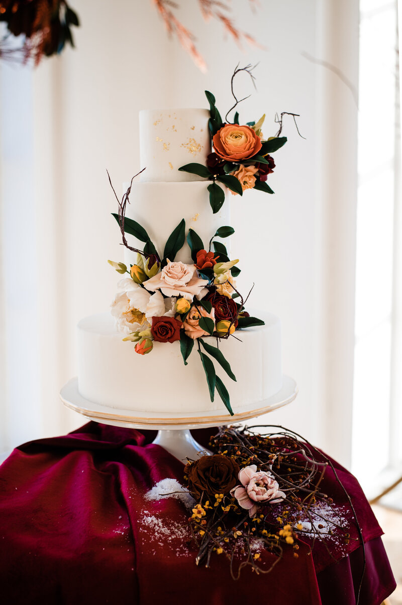 Goregous wedding cake with sugar flowers accentuated with gorgeous velvet texture