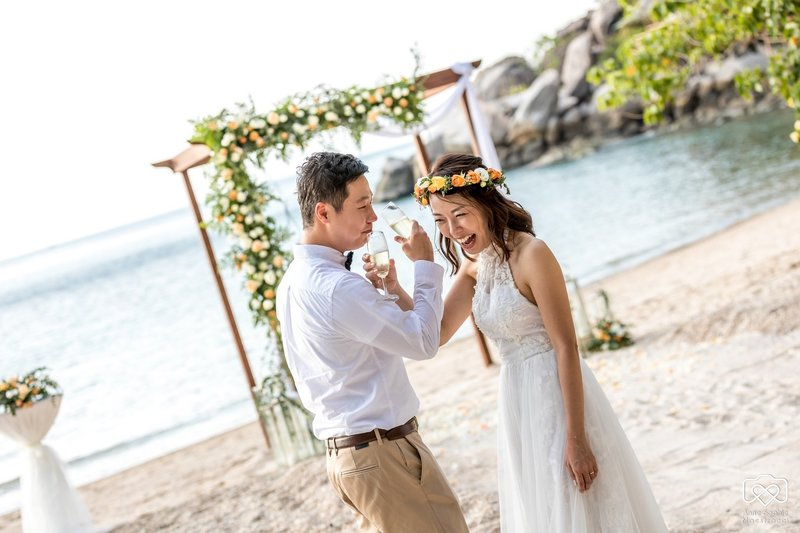 Couple with wedding arch on Koh Tao